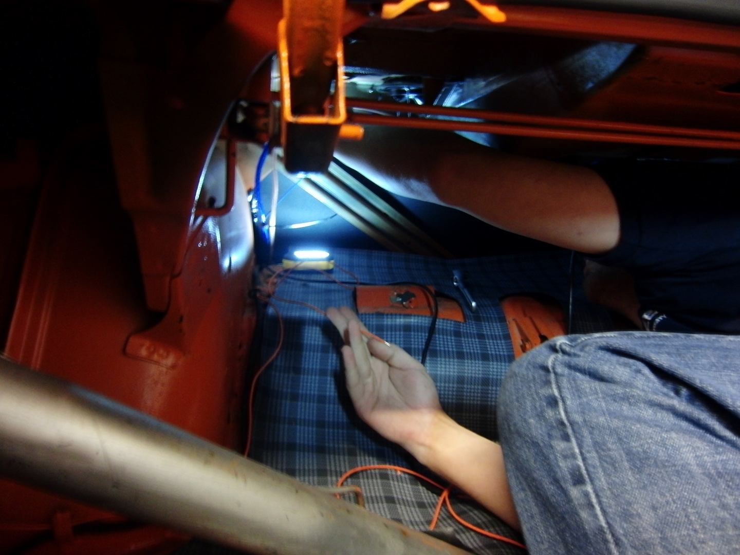 I had Mike squeeze in the trunk and tap the orange wire to a constant power source that is used for the stereo. Many times we tap into the trunk light or ...